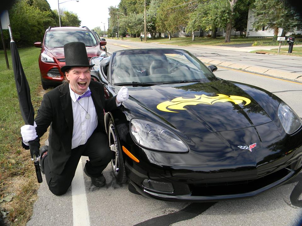 Batman super-villain The Penguin poses with Mullin's Batmobile