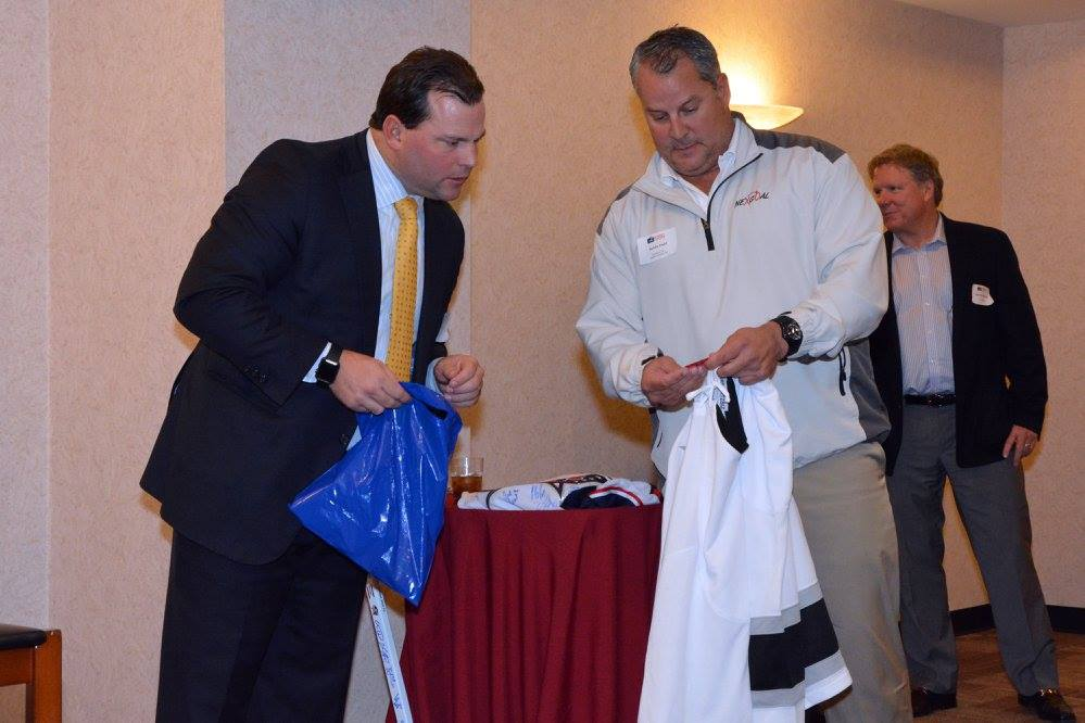 NexGoal CEO Kevin Dahl helps hand out prizes at the event. Photo credit: Hockey Players in Business