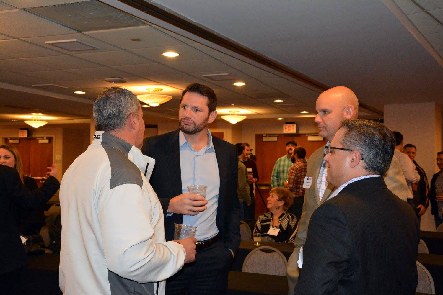 Kevin Dahl networks with another former NHLer in Jody Shelley. Photo Credit: Hockey Players in Business.