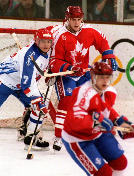 Kevin Dahl playing for Team Canada in the Olympics where he won a Silver Medal.